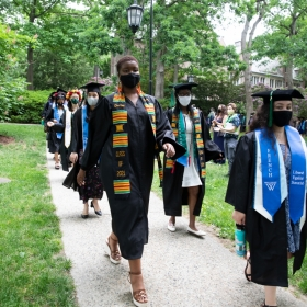Students process during commencement