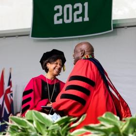 President Paula Johnson congratulates Selwyn R. Cudjoe