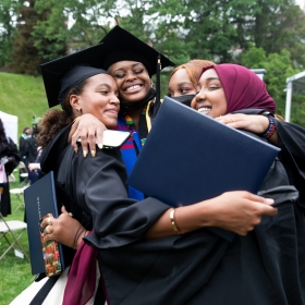 Students embrace after commencement