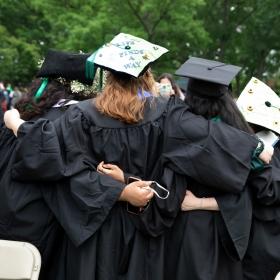 Graduates embrace after commencement