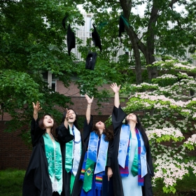 Students toss their tams after commencement