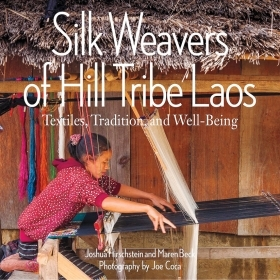 The cover of Silk Weavers of Hill Tribe Laos is a photograph of a young girl working at at outdoor loom.