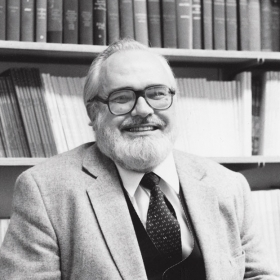 A photo portrait of Edward Hobbes, professor of religion, in his College office