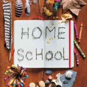 "A photo collage around the words ""Home School"" contains rocks and fatehrs, crayons, leaves, and child-size scissors."