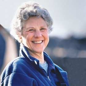 A photo portrait shows a smiling Amalie Moses Kass '49