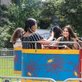 Students enjoy a carnival ride on Lake Day