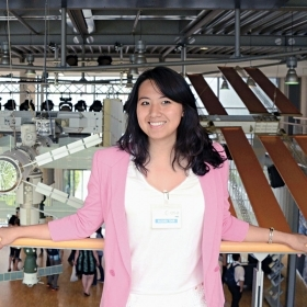 A photo of Charlotte Kiang '13 standing in the European Astronaut Centre in Germany
