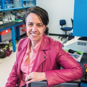 A portrait of Andrea Sequeira, a professor of biological sciences, in her lab.