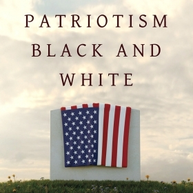 The cover image of Patriotism Black and White depicts an American flag draped over a white marble tombstone.
