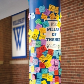 PERA's Pillar of Gratitude in the sports center featuring colorful sticky notes expressing thanks from students for a wide variety of things