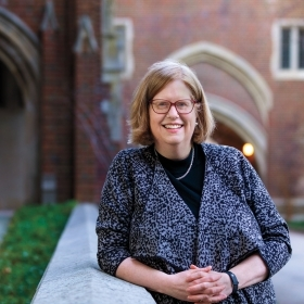 A photo portrait of Alice Hummer outside Green Hall at Wellesley