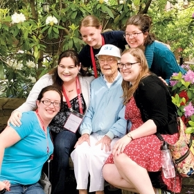 A photo of Mary Hall Hastings '37 surrounded by members of the class of 2012