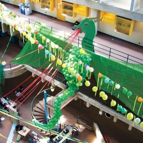 A giant green dragon that seniors made of balloons, crepe paper, and cardboard presides over the Science Center.