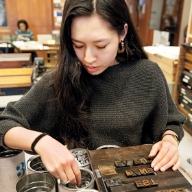 A student sets type