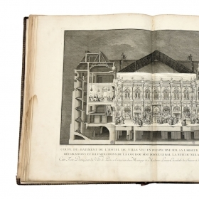 A photo shows a cross-section illustration of French aristocrats dancing at a wedding. The 18th-century festival book measures 25 inches high and 37 ½ inches across when open..