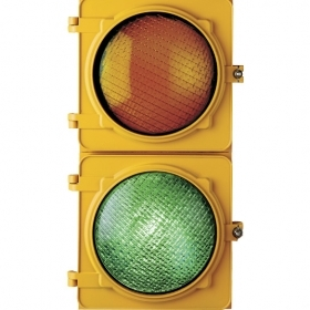 An image of a stoplight, showing only the yellow and green lights. The yellow is unlit; the green is lit.