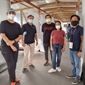 Architect Denise Villar de Castro '98 and her collaborators stand in an emergency quarantine facility they created outside the Taguig Pateros District Hospital.