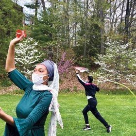 A. photo shows Muslim students flying kites while celebrating Eid on campus in spring 2021.