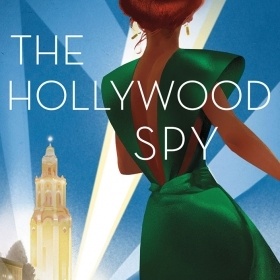 """The cover of """"The Hollywood Spy"""" is a painting of a woman in a 1940s' evening gown, looking toward LA at night."""