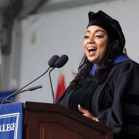 A photo of Massachusetts State Rep. Liz Miranda '02 delivering her commencement address