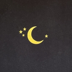 Cover of Grace Ramsdell's diary; a black notebook with a yellow crescent moon and four stars