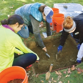 Students dig by the site of College Hall.