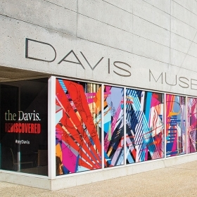 Photo of David Teng Olsen's mural  in the windows of the Davis courtyard.