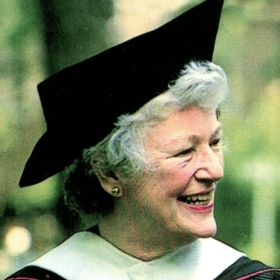 A photo of Betty Freyhof Johnson '44 wearing academic robes.
