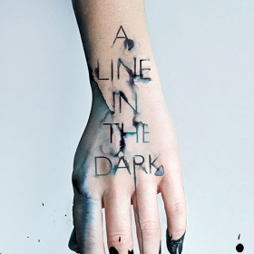 The cover of Malinda Lo's novel. A Line in the Dark, shows a photograph of a hand with dark ink dripping off the fingers.