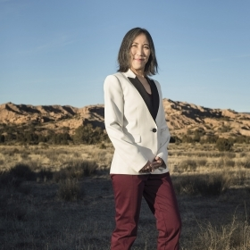 Liz Miranda '02 campaigning in Massachusetts; Lisa Shin '91 poses in the New Mexico desert.