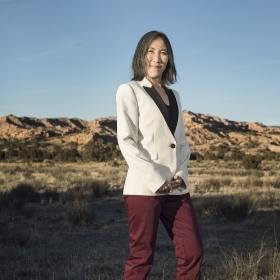 Liz Miranda '02 campaigning in Massachusetts; Lisa Shin '91 poses in the New Mexico desert.