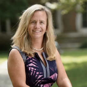 Portrait of Missy Siner Shea '89 sitting in Academic Quad