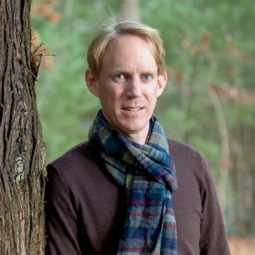A photo portrait of Alden Griffith, assistant professor of environmental studies