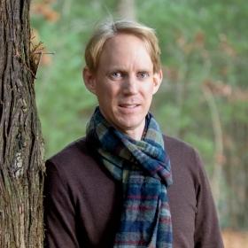 A photo portrait of Alden Griffith, assistant professor of environmental studies