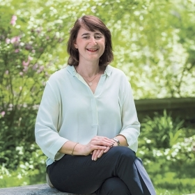 Martha Goldberg Aronson '89, president, Wellesley College Alumnae Association, sits on a bench outside Green Hall