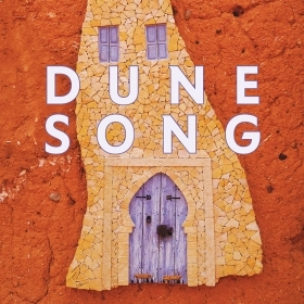 The cover of Dune Song by Anissa Bouziane depicts the closed door of a Moroccan house.