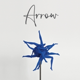 The cover of ARROW shows an illustration of a flower motif with its petals rendered as dark-blue women's legs.