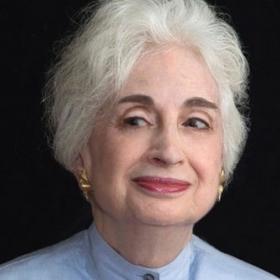 In a photo portrait, Judith Perlman Martin '59 smiles sardonically.