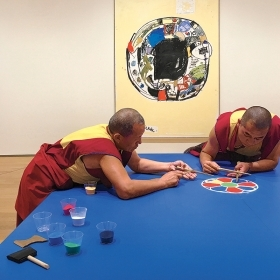 Photo of monks assembling a mandala out of sand in the Davis Museum.